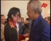 waptrick.com Michael Jackson attends Nelson Mandelas Private Birthday Party 1996