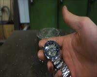 waptrick.com Crushing Watch With Hydraulic Press