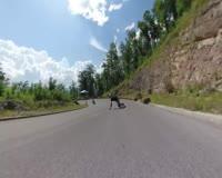 waptrick.com Women is Downhill Longboarding at Full Speed
