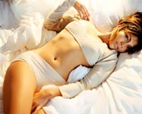 Jennifer Lopez on bed