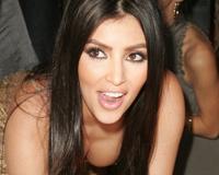 Kim Kardashian Bends Over Exposing Cleavage
