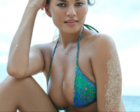Christine Teigen With Turquoise Bikini